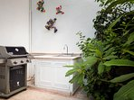 The new Weber gas grill, food preparation area and outdoor sink.