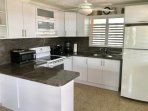 Modern Kitchen with Refrigerator, Electric Range & Oven, Microwave, Coffeemaker, Toaster & Blender
