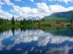 Drive 25 minutes north to hike, feed ducks or fish in private, stocked Molas Lake