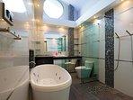 Bathroom 2 with bathtub and double rain showers