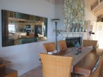 Indoor dining is by the head coral fireplace which is easily turned on remotely for ambiance!
