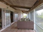 Screened East patio with ample seating for the entire crowd.