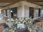This is the best spot in the house. The corner of the screened porch boasts 2 chaise lounges w/views