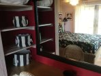 Guest room closets have builtins for your convenience with a writing desk.
