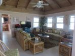 Large living room has ample seating for 8, WIFI TV and cable are added for your entertainment.