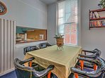 The table in the living room with seating for 5 is perfect for dining or playing a late-night card game.