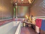 Rinse off in the bath tub.