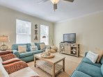 During your downtime, lounge in the living room that offers ample seating and watch a movie on the flat-screen cable TV.