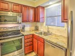 The condo has brand new stainless steel kitchen appliances.