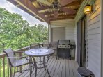 Grill your favorite foods on the back deck and dine al fresco at the patio table.