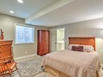 The large bedroom provides a sanctuary with black out shades and a plush queen-sized bed.