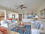 Make yourself at home in this spacious living area, equipped with comfortable furnishings and a flat-screen cable TV.