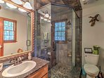 The ensuite master bathroom was recently remodeled and features a walk-in glass shower.