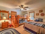 The second bedroom features a queen bed and a twin-over-twin bunk bed.