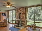 Natural light flooding from floor-to-ceiling windows welcome you upon entering the home.