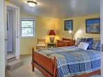 The master bedroom boasts a queen-sized bed and an en suite bathroom.