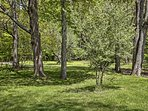 Lush, tree-filled woods create a peaceful lakefront destination!