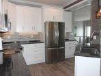 Modern New Kitchen Granite Counters Stainless Appliances Stunning Tile backsplash