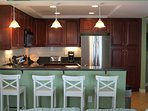 Kitchen has new Stainless Appliances and seating for up to 12 for dining in