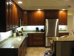 Modern Large Kitchen has lots of Granite Counter Space