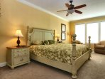 Master Bedroom has King bed and 2 tub chairs by the oceanview windows