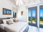Bedroom with a double bed and balcony with sea view