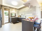 The main fully equipped kitchen on the ground floor
