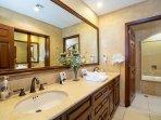 Master bathroom/jacuzzi tub/shower/walkin closet w/wall safe.