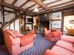 Sitting room with open fire, central heating and a wealth of oak beams