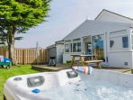 Hot tub, deck, picnic table & benches, Bbq, washing line & trolley for the beach