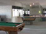 Partial View of the Family Room with Bar and Pool Table