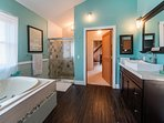 Master bath with large jacuzzi tub and 4' x 4' double shower