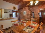 Dining room and brick wall in kitchen