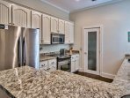 Granite and stainless steel kitchen with new glass door pantry