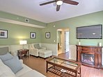 The spacious living area features a flat-screen cable TV, comfortable furniture and a decorative fireplace.