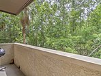 Take in the fresh air and peaceful tree views from the private balcony with gas grill.