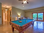 The ground-level has a pool table to keep you entertained.