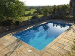 Newly refurbished heated swimming pool with integral steps for easy access (open May-Sept)