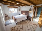 First bedroom in guesthouse (kingsize) - leads directly onto shared bathroom with bath and shower