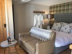 Totally relax in Merlin with luxury king size bed, bathrobes and high quality bed linen.