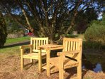 Sit at the love seat,  watch the sun go down over the Metheith hills and enjoy a glass of wine.