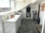 Large kitchen and dining area with great sea views and access to balcony