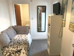 Snug, leading to second bedroom, with day bed and ensuite toilet