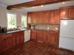Fully equipped tiled kitchen