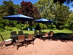 Outdoor dining seats 10 plus chaise lounges and more patio seating.