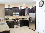 upgraded kitchen with granite counter tops, stainless appliances