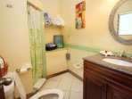Nice bathroom with beach and bat towels