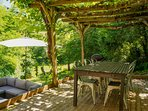 The outside dining area under the grape vines
