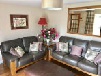 The large patio doors provide lots of natural light, easy access to the garden and lovely views