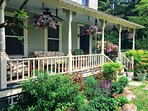 Relax or dine on our wraparound front porch
